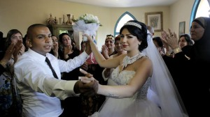 Groom Mahmoud Mansour, 26, and his bride Maral Malka, 23, celebrate with friends and family before their wedding in Mahmoud's family house in Jaffa, south of Tel Aviv